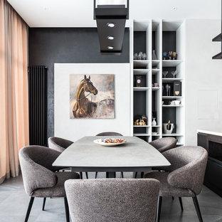 Ejemplo de comedor de cocina contemporáneo con paredes negras, suelo de baldosas de porcelana y suelo gris