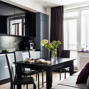 Esempio di una sala da pranzo aperta verso la cucina minimal di medie dimensioni con pareti bianche, pavimento in gres porcellanato e pavimento nero