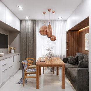 Diseño de comedor actual, pequeño, sin chimenea, con suelo de baldosas de porcelana y suelo blanco