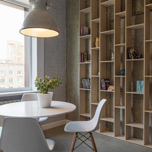 Immagine di una piccola sala da pranzo industriale con pareti grigie, nessun camino e pavimento grigio