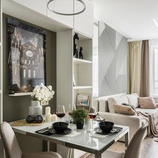 Идея дизайна: гостиная-столовая в современном стиле с белыми стенами, паркетным полом среднего тона и коричневым полом