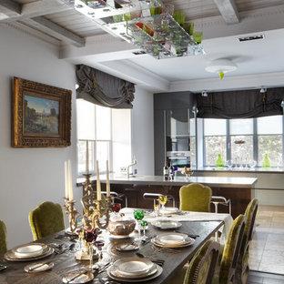 На фото: большая кухня-столовая в классическом стиле с серыми стенами и темным паркетным полом