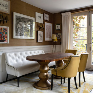 Inspiration for a bohemian dining room with brown walls, dark hardwood flooring and brown floors.