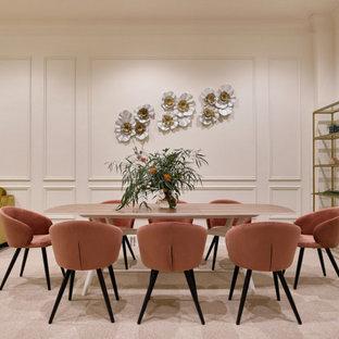 На фото: гостиная-столовая в современном стиле с бежевыми стенами, бежевым полом и панелями на стенах без камина
