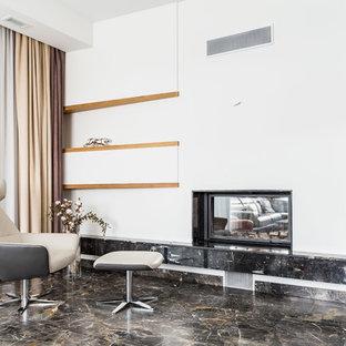 Идея дизайна: большая кухня-столовая в современном стиле с белыми стенами, полом из керамогранита, двусторонним камином, фасадом камина из камня и коричневым полом