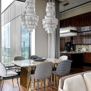 Свежая идея для дизайна: гостиная-столовая в современном стиле с паркетным полом среднего тона, коричневым полом и серыми стенами - отличное фото интерьера