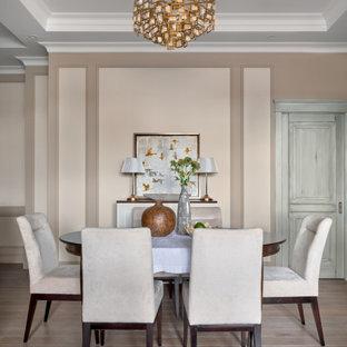 На фото: гостиная-столовая среднего размера в стиле современная классика с бежевыми стенами, бежевым полом и панелями на части стены без камина