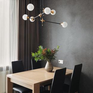 Пример оригинального дизайна: столовая в современном стиле с черными стенами без камина