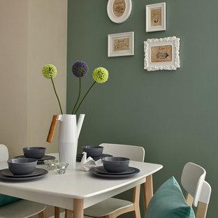 Imagen de comedor escandinavo con paredes verdes