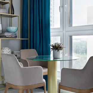 На фото: маленькая гостиная-столовая в современном стиле с серыми стенами и белым полом без камина
