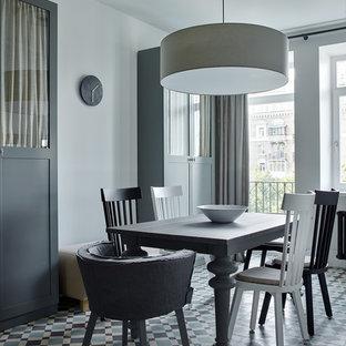 Пример оригинального дизайна интерьера: отдельная столовая среднего размера в стиле современная классика с белыми стенами, полом из керамической плитки и разноцветным полом
