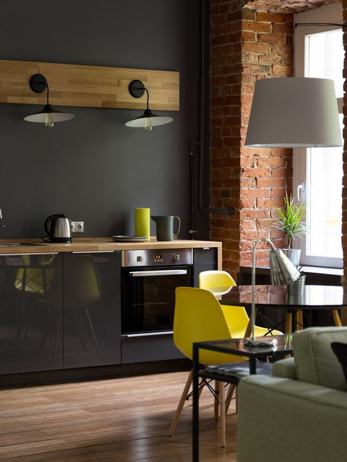 industrial esszimmer mit bambusparkett ideen design bilder houzz. Black Bedroom Furniture Sets. Home Design Ideas