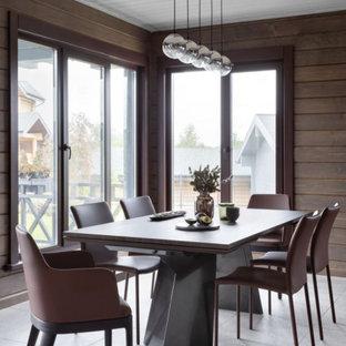 Идея дизайна: большая кухня-столовая в современном стиле с коричневыми стенами и серым полом