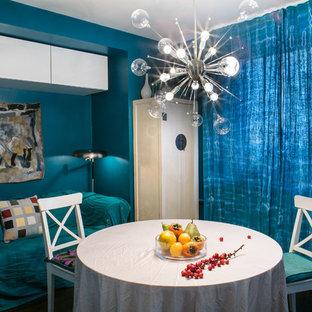 Esempio di una piccola sala da pranzo aperta verso la cucina minimal