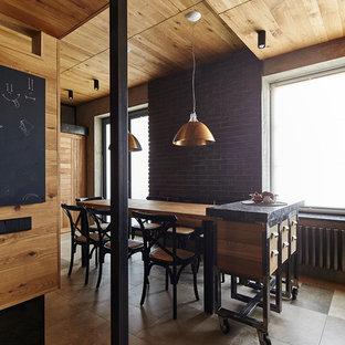 На фото: маленькие гостиные-столовые в стиле лофт с полом из керамической плитки и серым полом