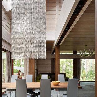На фото: гостиная-столовая в современном стиле с