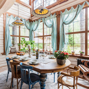 Example Of A Country Carpeted Dining Room Design In Saint Petersburg With Beige Walls