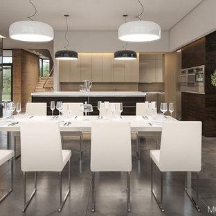 Modelo de comedor de cocina minimalista, de tamaño medio, con paredes negras, suelo de baldosas de cerámica, chimenea de doble cara, marco de chimenea de hormigón y suelo gris