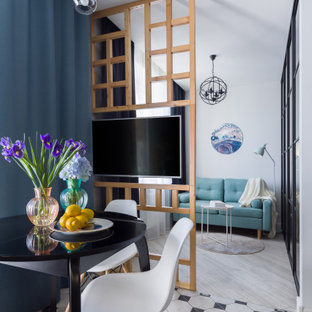 На фото: маленькая гостиная-столовая в современном стиле с белыми стенами и разноцветным полом