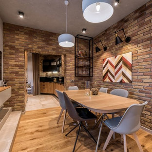 Example of an urban medium tone wood floor and brown floor dining room design in Other with brown walls