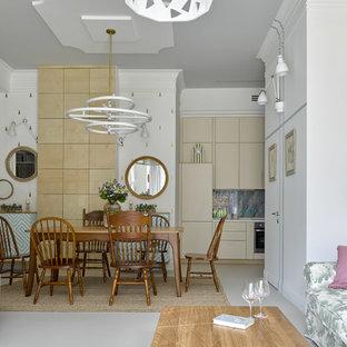 Удачное сочетание для дизайна помещения: гостиная-столовая среднего размера в современном стиле с бетонным полом, белым полом и белыми стенами - самое интересное для вас