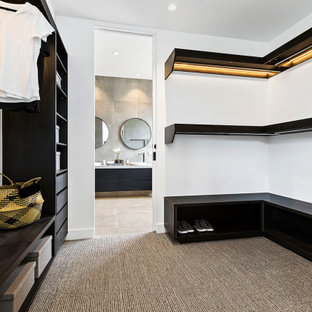 This is an example of a contemporary storage and wardrobe in Melbourne.