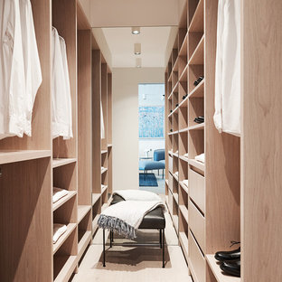 Inspiration for a contemporary gender-neutral walk-in wardrobe in Sydney with open cabinets, light wood cabinets, light hardwood floors and beige floor.