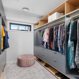 Inspiration for a small contemporary gender-neutral walk-in wardrobe in Gold Coast - Tweed with flat-panel cabinets, grey cabinets, carpet and grey floor.