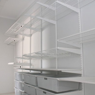 Mid-sized gender-neutral walk-in wardrobe in Darwin with open cabinets, white cabinets and porcelain floors.