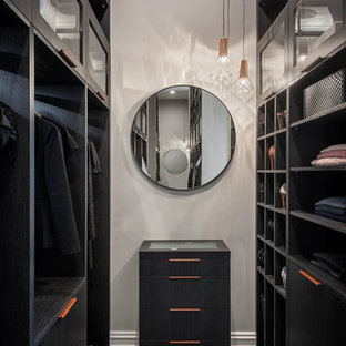 Photo of a contemporary gender-neutral dressing room in Adelaide with open cabinets, black cabinets, carpet and grey floor.