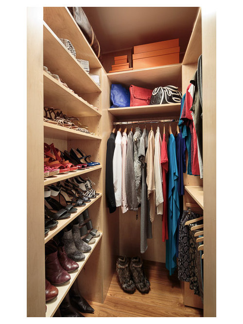 Inspiration For A Small Contemporary Womenu0027s Medium Tone Wood Floor Walk In  Closet Remodel In
