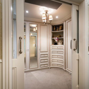Photo of a large traditional gender-neutral walk-in wardrobe in Perth with recessed-panel cabinets, distressed cabinets and carpet.