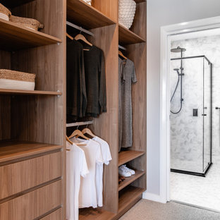 Design ideas for a contemporary walk-in wardrobe in Sydney with open cabinets, medium wood cabinets, carpet and grey floor.