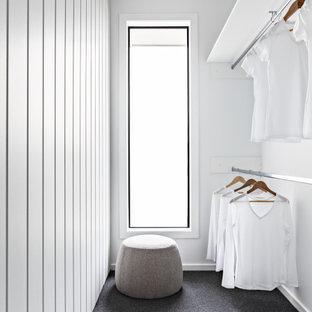 Design ideas for a scandinavian women's walk-in wardrobe in Melbourne with carpet and grey floor.