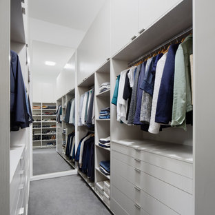Inspiration for a mid-sized contemporary gender-neutral walk-in wardrobe in Melbourne with flat-panel cabinets, grey cabinets, carpet and grey floor.