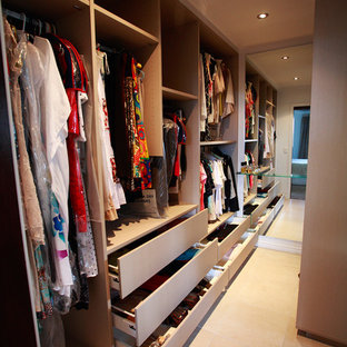 Design ideas for a large classic gender neutral walk-in wardrobe in Brisbane with open cabinets, travertine flooring and beige floors.
