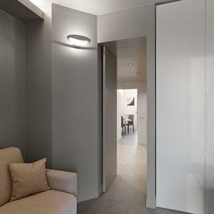 Idee per un atelier design di medie dimensioni con pareti grigie, pavimento in gres porcellanato e pavimento grigio