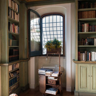 Inspiration for a large traditional home office and library in Other with beige walls, terracotta flooring and brown floors.