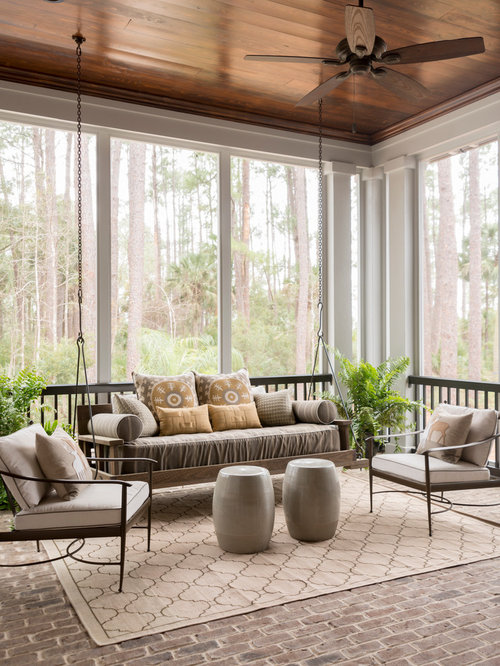 large transitional brick floor and gray floor sunroom photo in charleston with a standard ceiling - Sunroom Ideas Designs