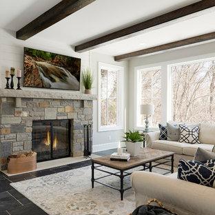 Großer Wintergarten mit Keramikboden, Kamin, Kaminumrandung aus Stein, normaler Decke und grauem Boden in Minneapolis