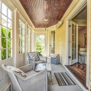 Elegant gray floor sunroom photo in New York with a standard ceiling