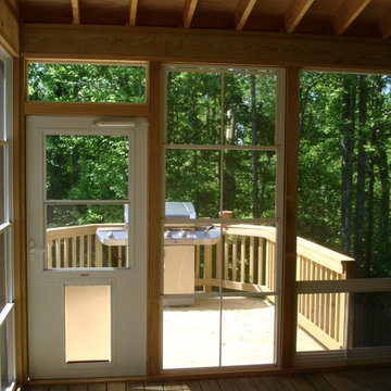 3 Season Room with Eze Breeze windows Leading to Wood Deck for Grilling