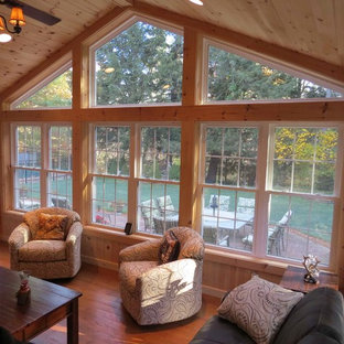 Example Of A Large Clic Medium Tone Wood Floor Sunroom Design In Manchester With Standard Save Photo 4 Season