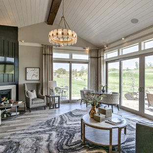Medium sized contemporary conservatory in Kansas City with laminate floors, a corner fireplace, a stone fireplace surround and grey floors.