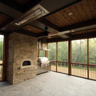 Mittelgroßer Uriger Wintergarten mit Keramikboden, Kamin, Kaminumrandung aus Stein, normaler Decke und beigem Boden in Indianapolis