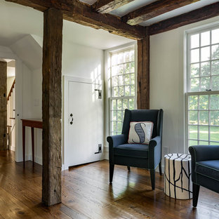 Large eclectic medium tone wood floor and brown floor sunroom photo in Bridgeport with no fireplace and a standard ceiling
