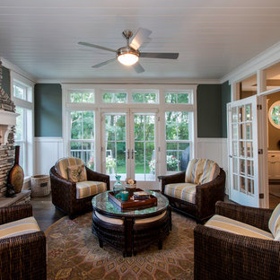 Mid-sized arts and crafts medium tone wood floor sunroom photo in Minneapolis with a stone fireplace, a standard ceiling and a standard fireplace