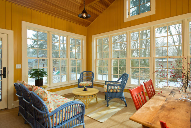 Farmhouse Sunroom by Phinney Design Group