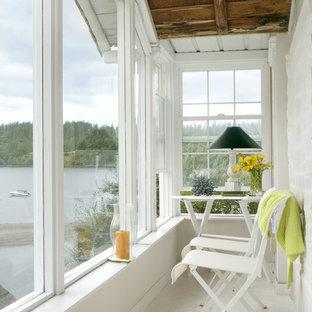 Ispirazione per una piccola veranda classica con soffitto classico