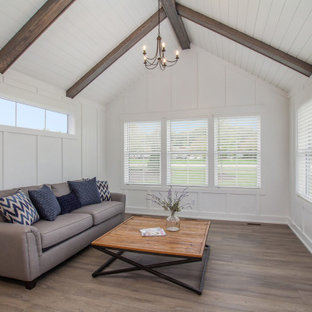 Inspiration for a mid-sized country vinyl floor and brown floor sunroom remodel in Grand Rapids with a standard ceiling and no fireplace